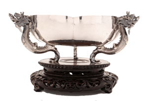 A chinese export silver bowl with dragon handles.